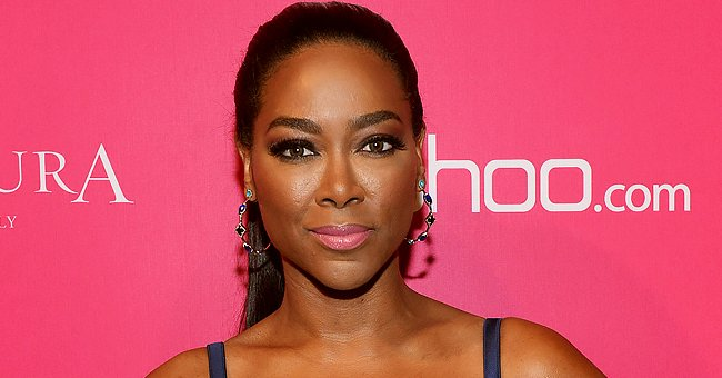 Kenya Moore Pours Her Curvy Figure into a Tight Black Lacy Strapless Dress — See Stunning Photo
