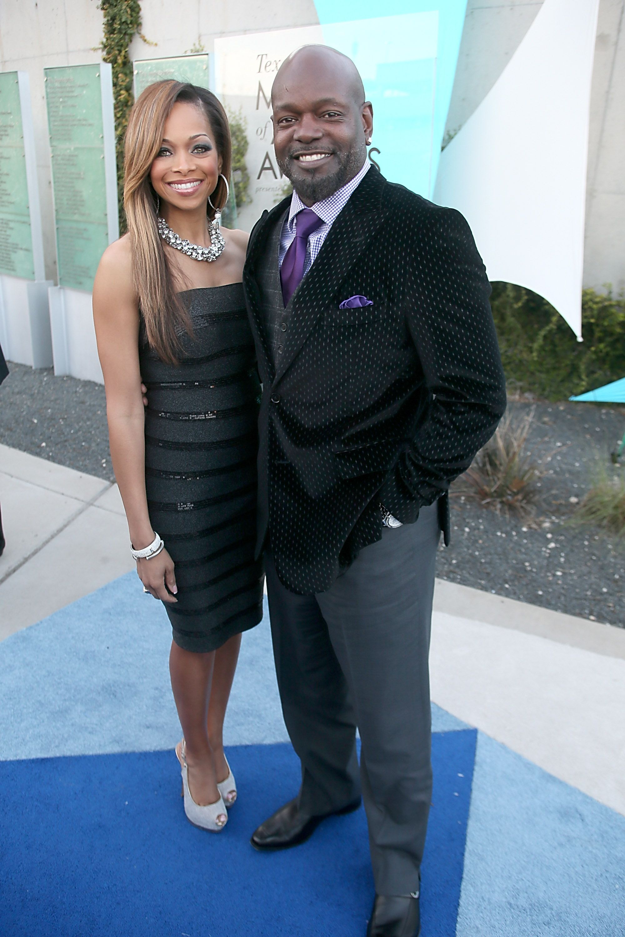 Patricia and Emmitt Smith walk the red carpet on March 5, 2013 in Austin. | Photo: Getty Images