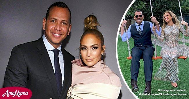 Jennifer Lopez a l'air sensationnelle dans une robe argentée pure comme elle partage une balançoire avec son beau