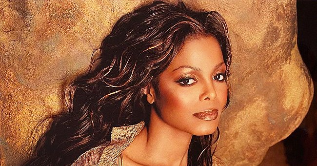 Janet Jackson Defies Her Age with Her Cleavage on Display in a Gorgeous Bronze Blouse (Photo)