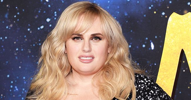 Rebel Wilson Gets a Kiss from Beau Jacob Busch as They Twin in Black-and-White Outfits