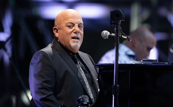 Billy Joel performing at his only concert in Germany. | Photo: Getty Images