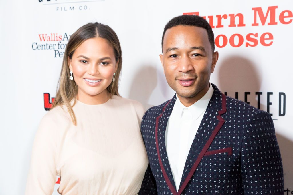 """Chrissy Teigen and John Legend pose during the """"Turn Me Loose"""" event on October 19, 2017   Photo: Getty Images"""