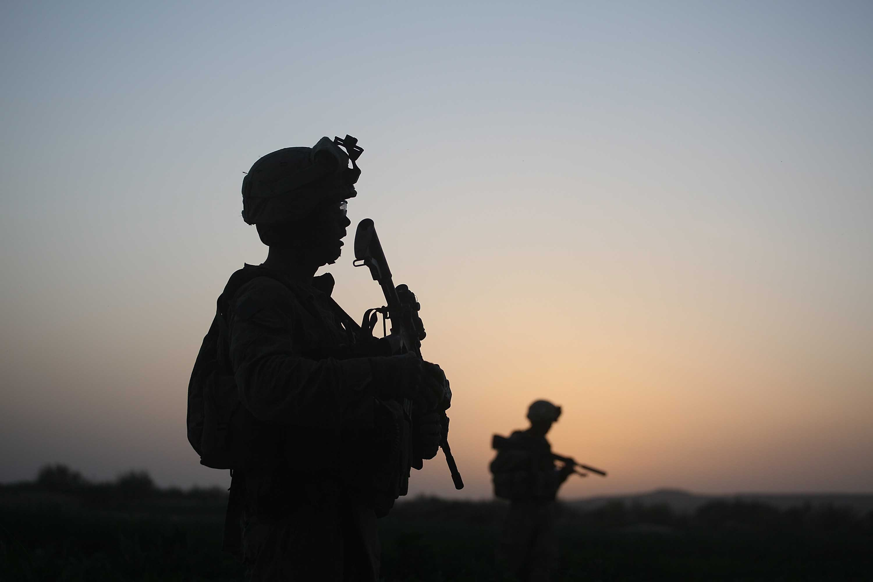 U.S. Marines with the 2nd Marine Expeditionary Brigade, RCT 2nd Battalion 8th Marines Echo Co. step off in the early morning during an operation to push out Taliban fighters on July 18, 2009 in Herati, Afghanistan | Getty Images: Photos
