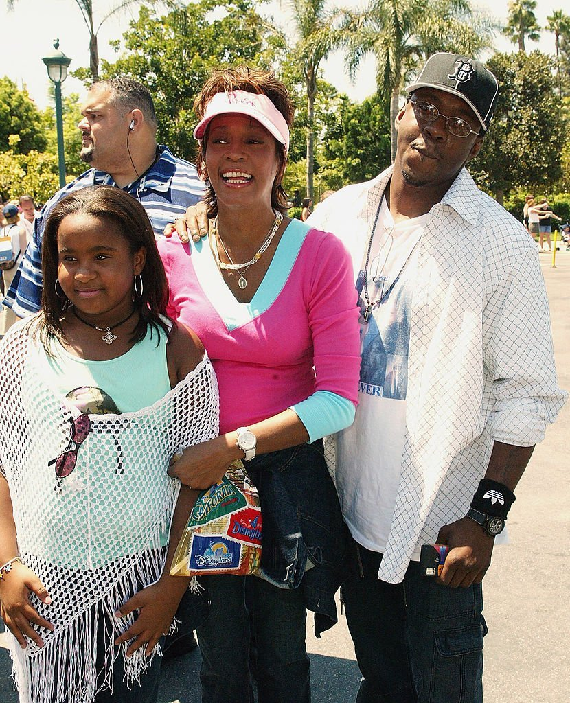 """A young Bobbi Kristina Brown with her parents, Whitney Houston and Bobby Brown attending the premiere of """"The Princess Diaries 2: Royal Engagement"""" in August 2004. 