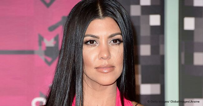 Kourtney Kardashian Wears Nothing but a Thong over Her Bare Chest to Promote a New Website