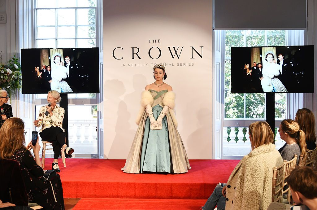 """Caryn Franklin and Michele Clapton speak as a model poses at a presentation featuring costumes from new Netflix Original series """"The Crown"""" with designer Michele Clapton at the ICA on October 17, 2016 