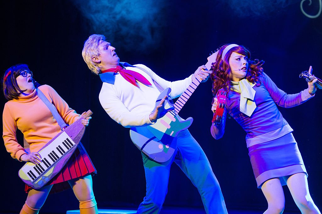 """Broadway actors channeling the famous characters of Velma, Fred and Daphne for the 2016 """"Scooby-Doo Live!"""" in London. 