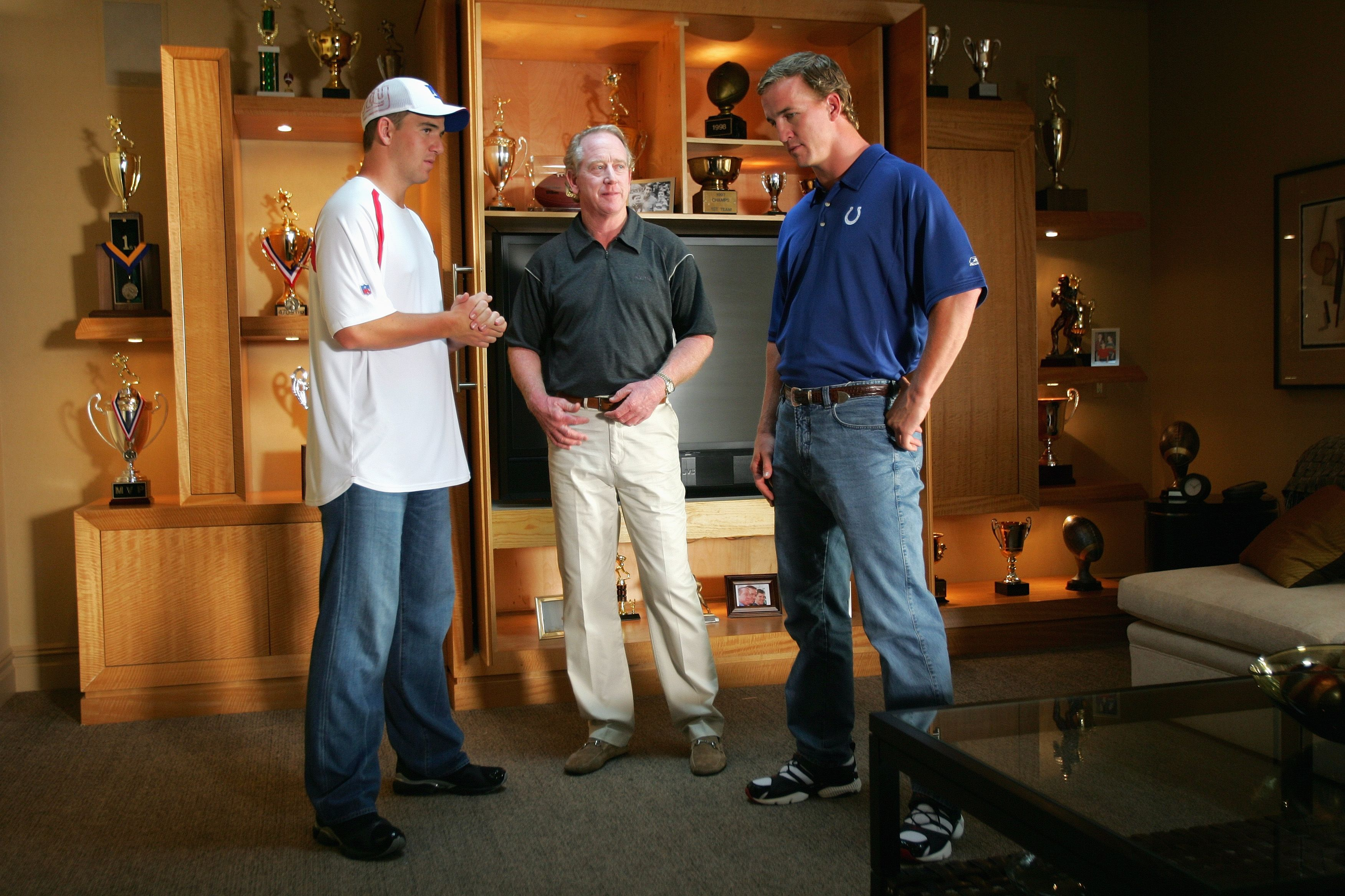 Archie and Peyton Manning on set during a Reebok commercial in 2006 in New Jersey   Source: YouTube.com/OfficialFritoLay