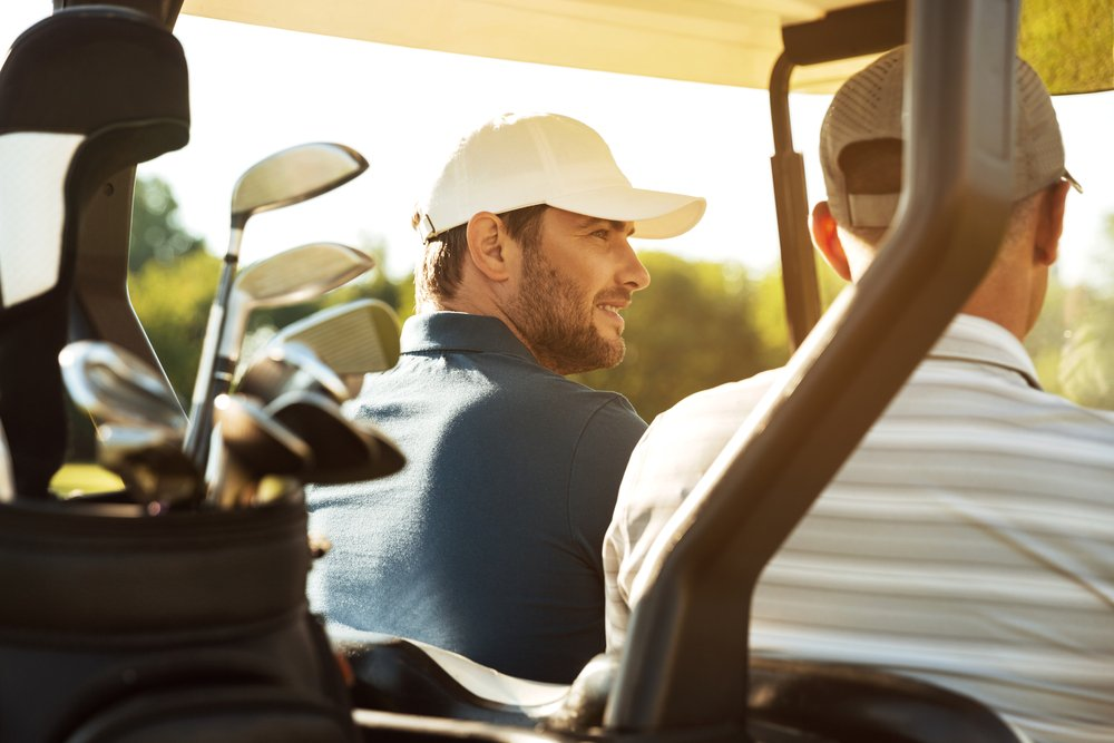 A photo of two friends out golfing | Photo: Shutterstock