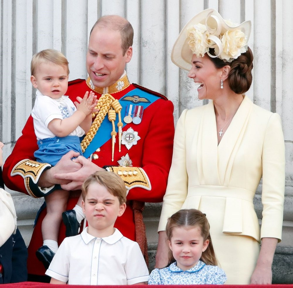 """Prince William, Kate Middleton, Prince Louis, Prince George, and Princess Charlotte at  Buckingham Palace during """"Trooping The Colour"""" in London, England in June 2019. 