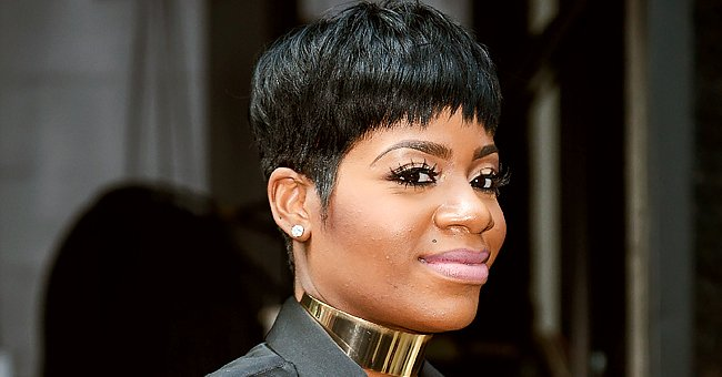 Fantasia Shows Her Growing Baby Bump as She Poses in a Tight Long-Sleeved Cream Dress (Photo)