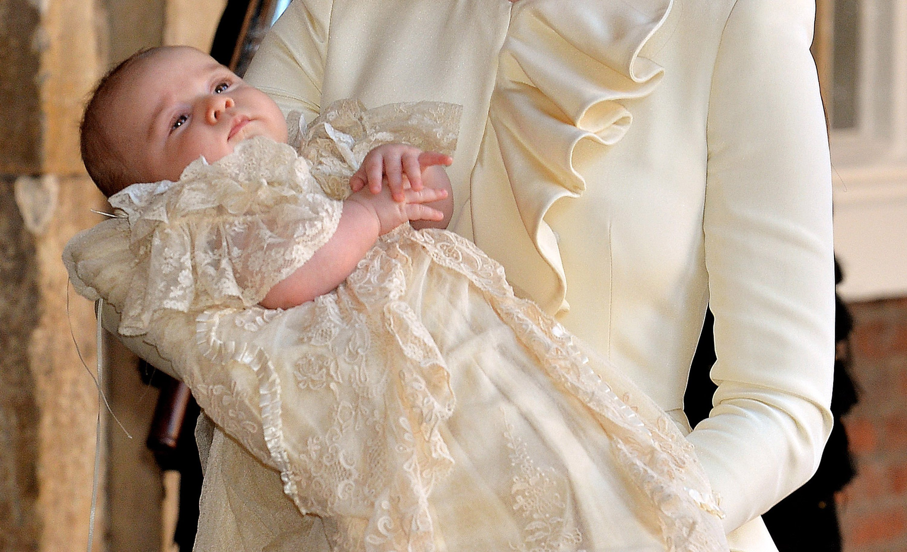 Catherine, Duchess of Cambridge carries her son Prince George Of Cambridge after his christening on October 23, 2013 in London, England.   Photo: Getty Images
