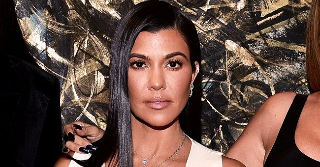 Kourtney Kardashian Puts on Leggy Display in a Photo with Son Reign and Fans React