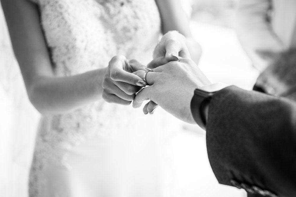 A couple exchanging rings on their wedding day | Photo: Shutterstock.com