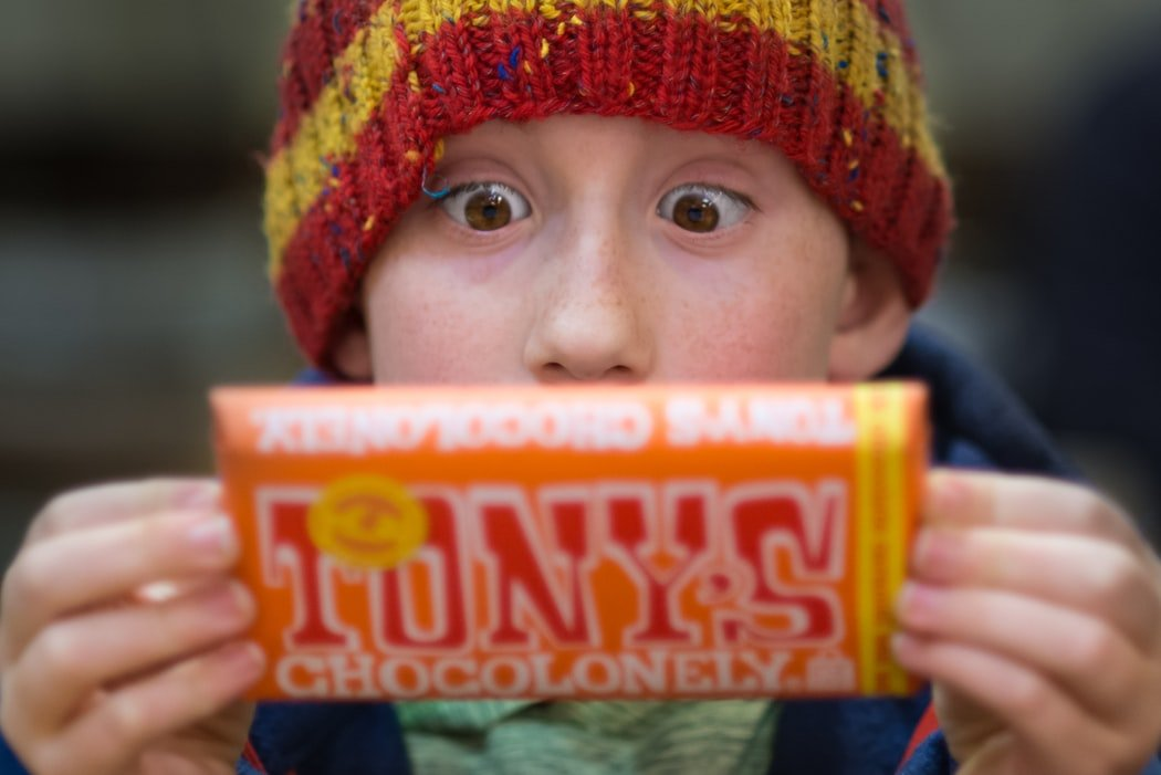 The boy was so happy to get a candy bar. | Source: Unsplash
