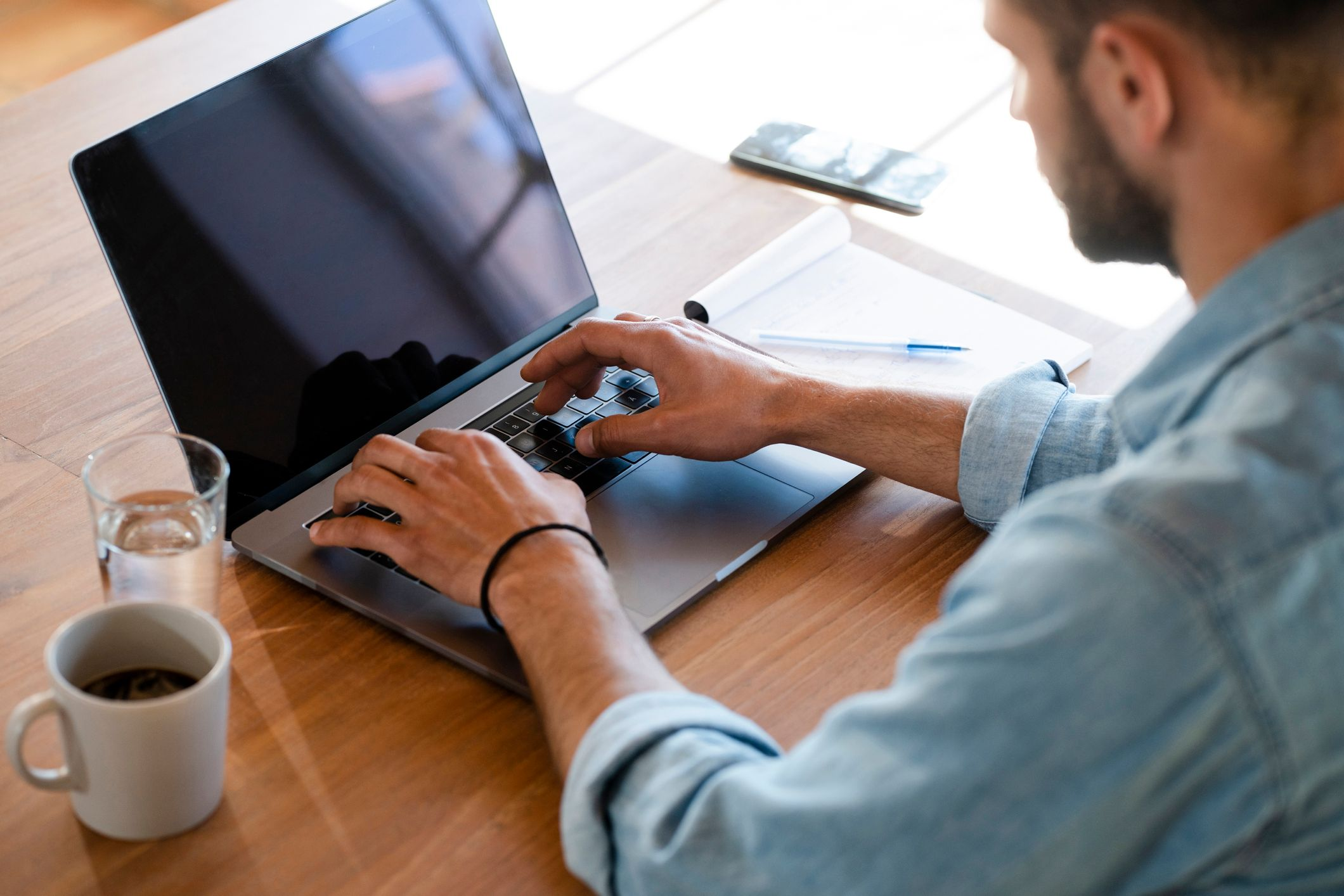 A man working on his laptop while having coffee.   Photo: Shutterstock