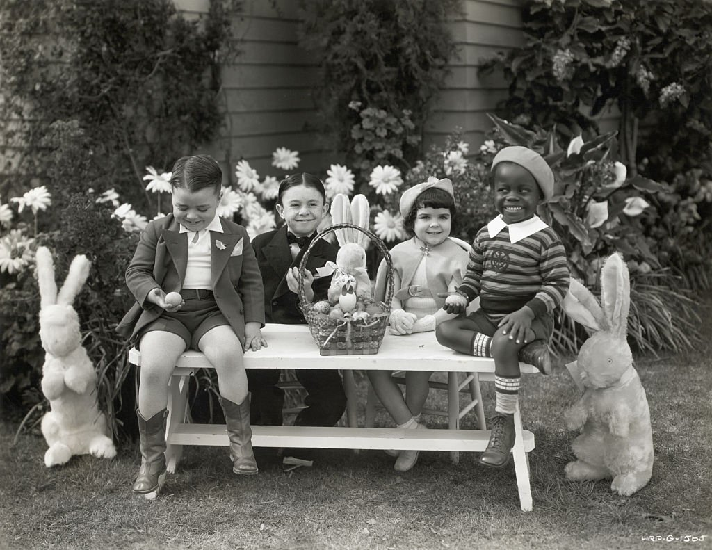 """Darla Hood and fellow """"Our Gang"""" kid stars celebrate Easter outdoors circa 1935. 