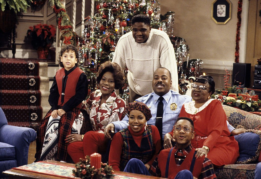 "Bryton James, Jo Marie Payton, Kellie Shanygne Williams, Daruis Mccrary, Reginald Vel Johnson, Jaleel White and Rosetta Lonoire pose on a couch during an episode of ""Family Matters on December 10, 1993. 
