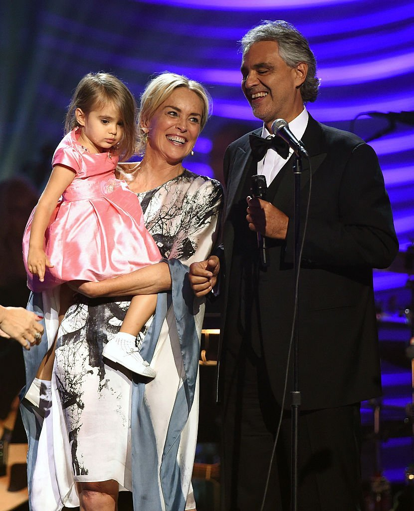 """Andrea Bocelli's daughter Virginia Bocelli is held by actress Sharon Stone after honoree Andrea Bocelli performed during the 19th annual Keep Memory Alive """"Power of Love Gala"""" benefit  