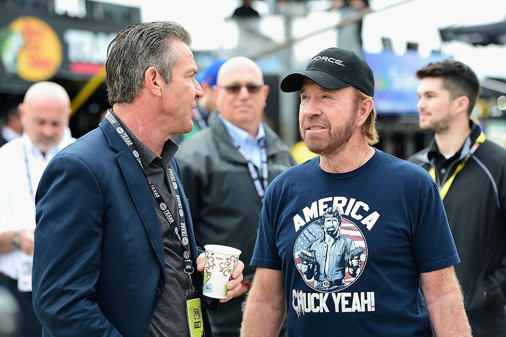 Dennis Quaid and Chuck Norris look on prior to the NASCAR Sprint Cup Series AAA Texas 500 at Texas Motor Speedway on November 6, 2016 in Fort Worth, Texas. | Source: Getty Images