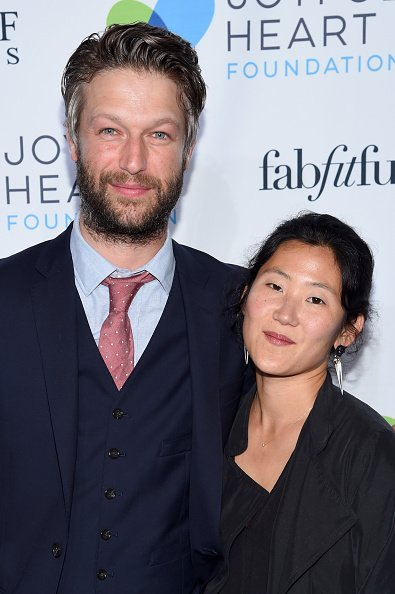 Peter Scanavino and Lisha Bai at The Joyful Revolution Gala In New York City on May 22, 2017 in New York City. | Photo: Getty Images