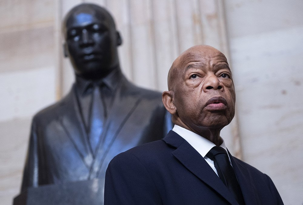 John Lewis, D-Ga., is seen near the statue of Dr. Martin Luther King, Jr., in the Capitol Rotunda before a memorial service for the late Rep. Elijah Cummings, D-Md., in Statuary Hall on Thursday, October 24, 2019. I Image: Getty Images.