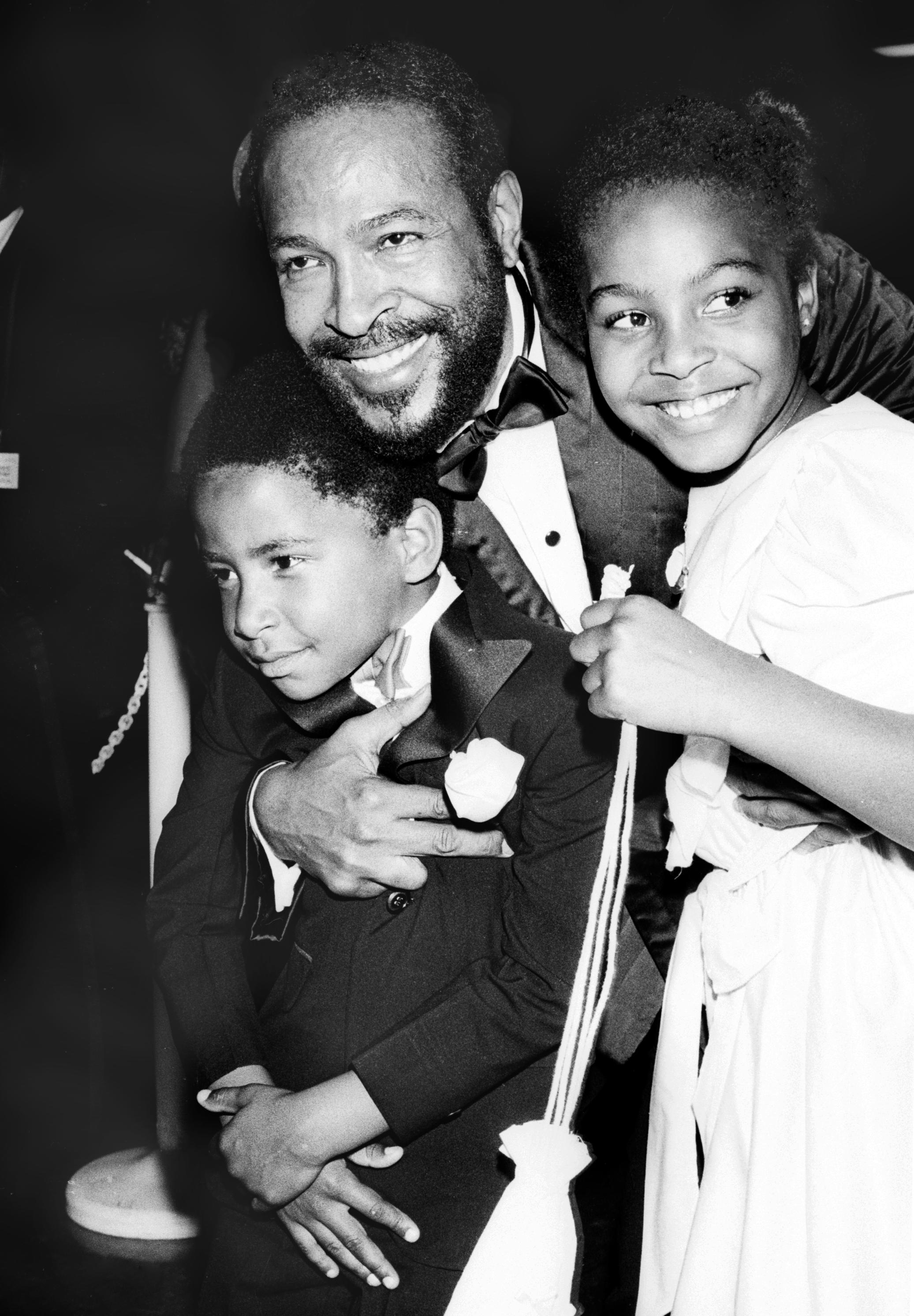 Soul singer Marvin Gaye hugs his children, Nona Gaye and Frankie Chirstian Gaye at an event in circa 1981. | Source: Getty Images