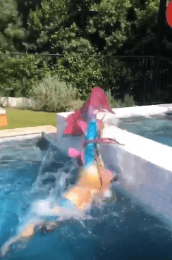 Julianne Hough showing off her fit body while swimming in a pool | Photo: Instagram/juleshough