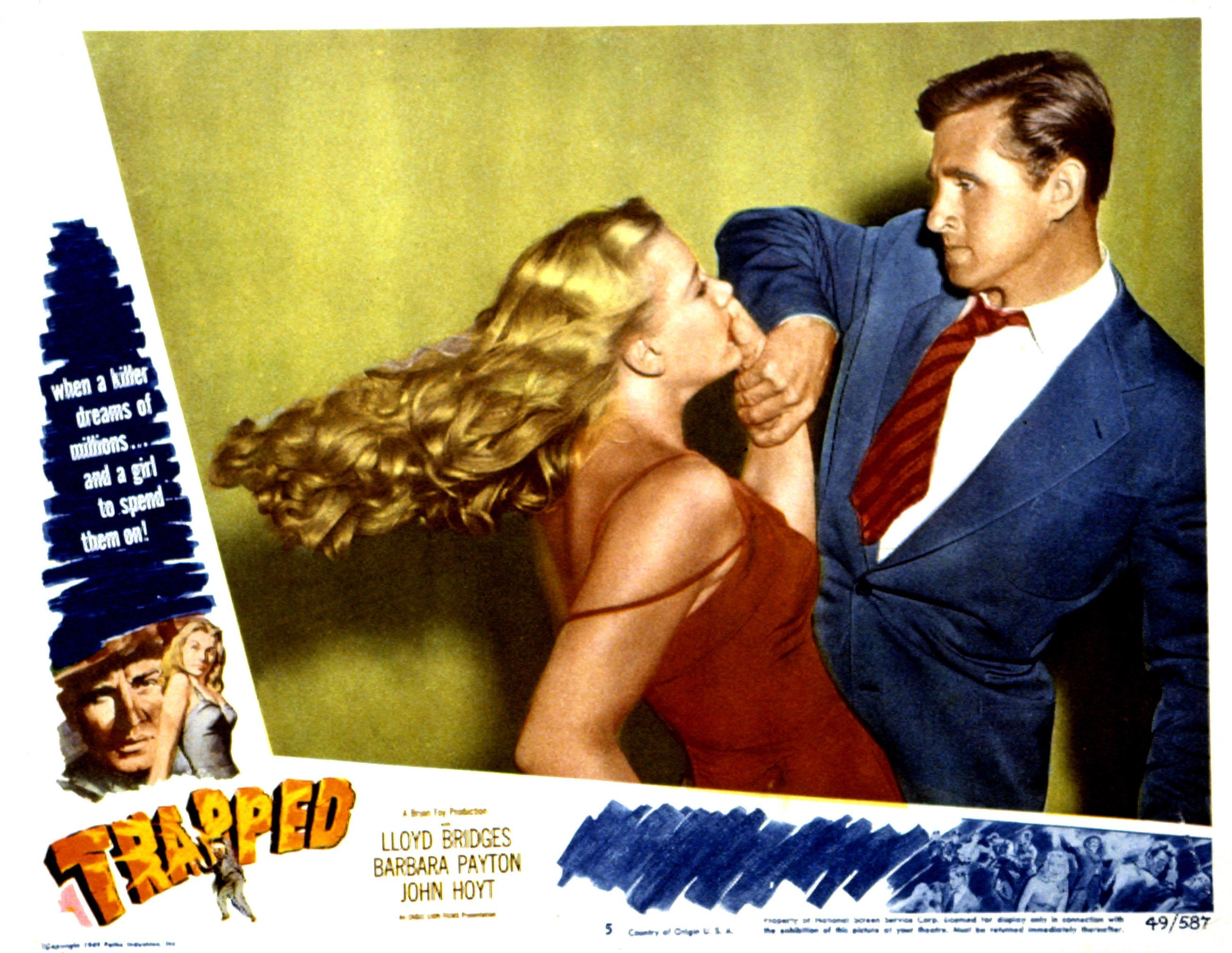 """A lobbycard from the movie """"Trapped"""" where Barbara Payton played the girlfriend to the lead actor, Lloyd Bridges, 1949 