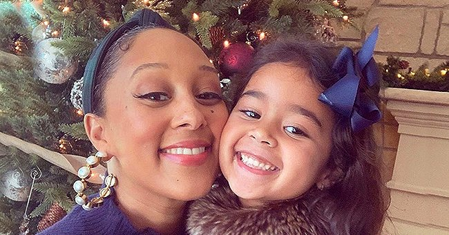 Tamera Mowry of 'The Real' Fame Lifts Daughter Ariah up With Her Feet in a New Quarantine Photo
