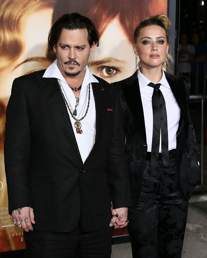 Johnny Depp and Amber Heard attend the premiere of Focus Features' 'The Danish Girl' at Westwood Village Theatre on November 21, 2015 in Westwood, California. | Photo: Getty Images