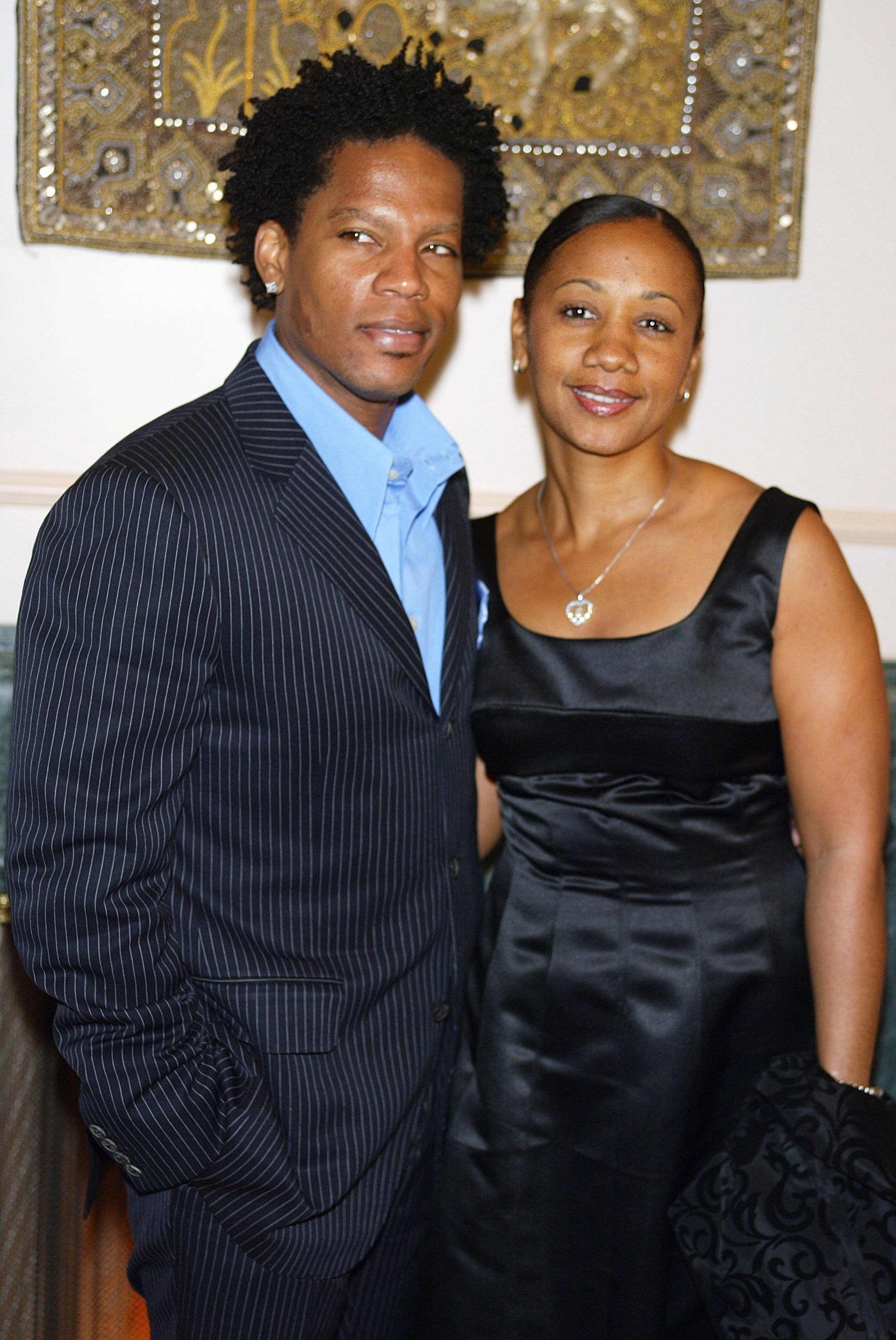 """D.L. Hughley and his wife LaDonna pose at """"Night of the Butterfly"""", hosted by Chrysalis, at a private residence on March 20, 2003 in Los Angeles 