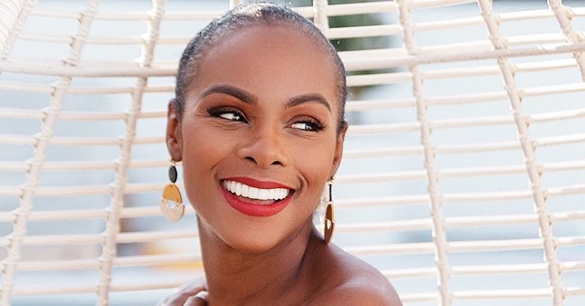 THATHN Actress Tika Sumpter Glows with Happiness as She Poses in an off-Shoulder Floral Outfit