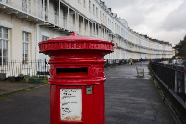 A Royal Mail postal box and a background of terraced homes on Royal York Crescent, on 26th December 2019, in Clifton, Bristol, England | Photo: Getty Images