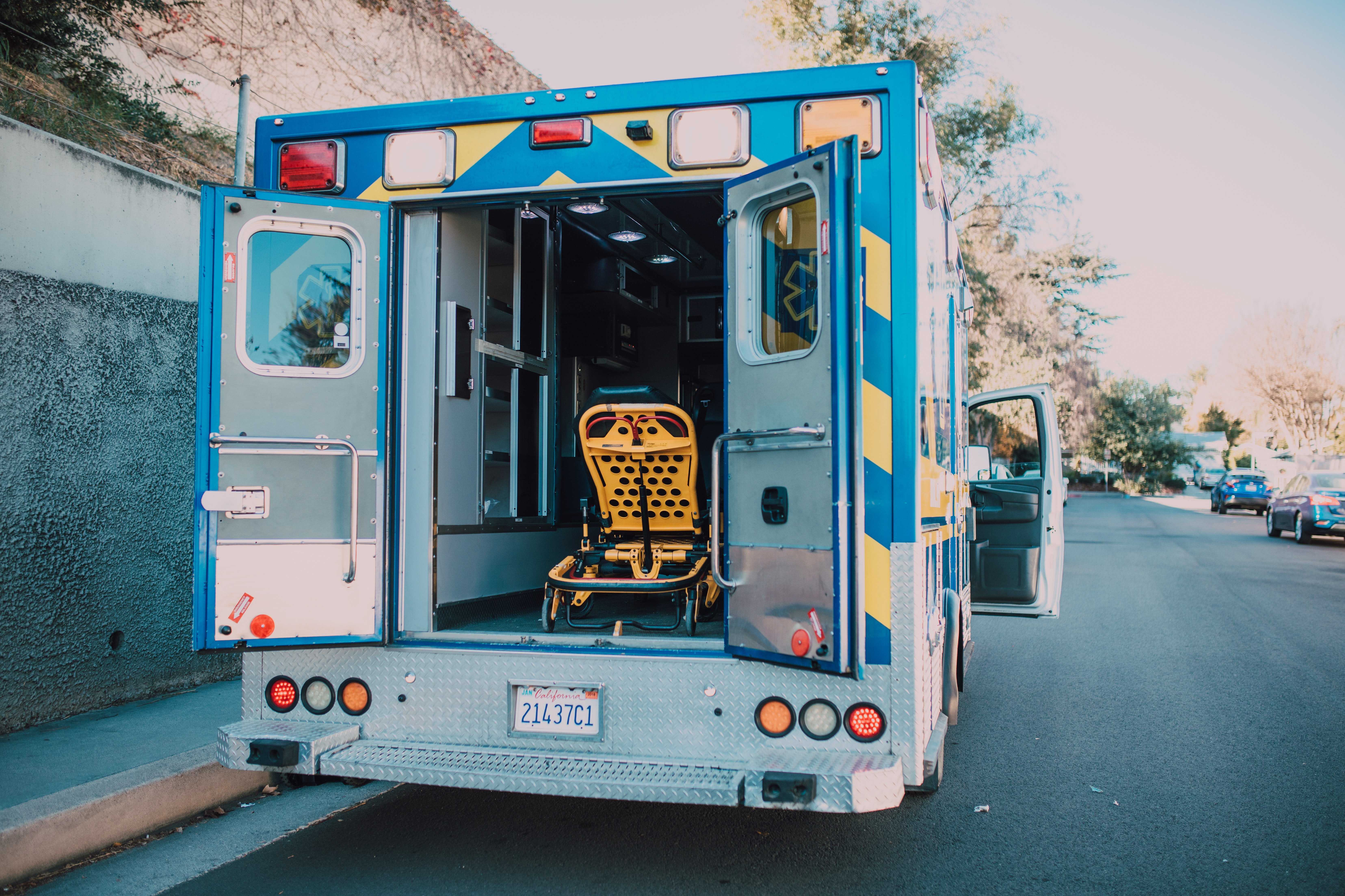 An ambulance with its back doors open.   Pexels