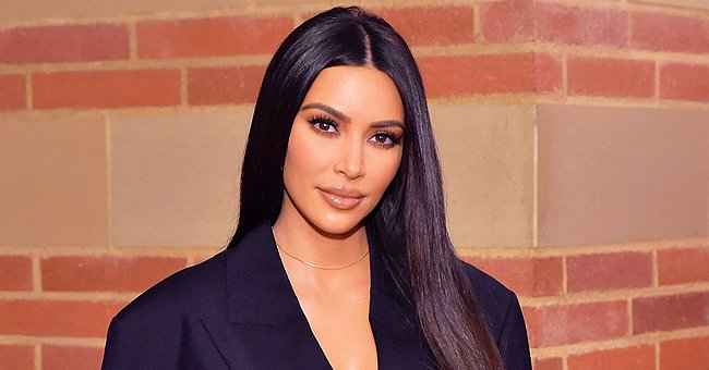 Kim Kardashian Shows off Her Sculptured Figure in Tights and Black Bra in a New Photo
