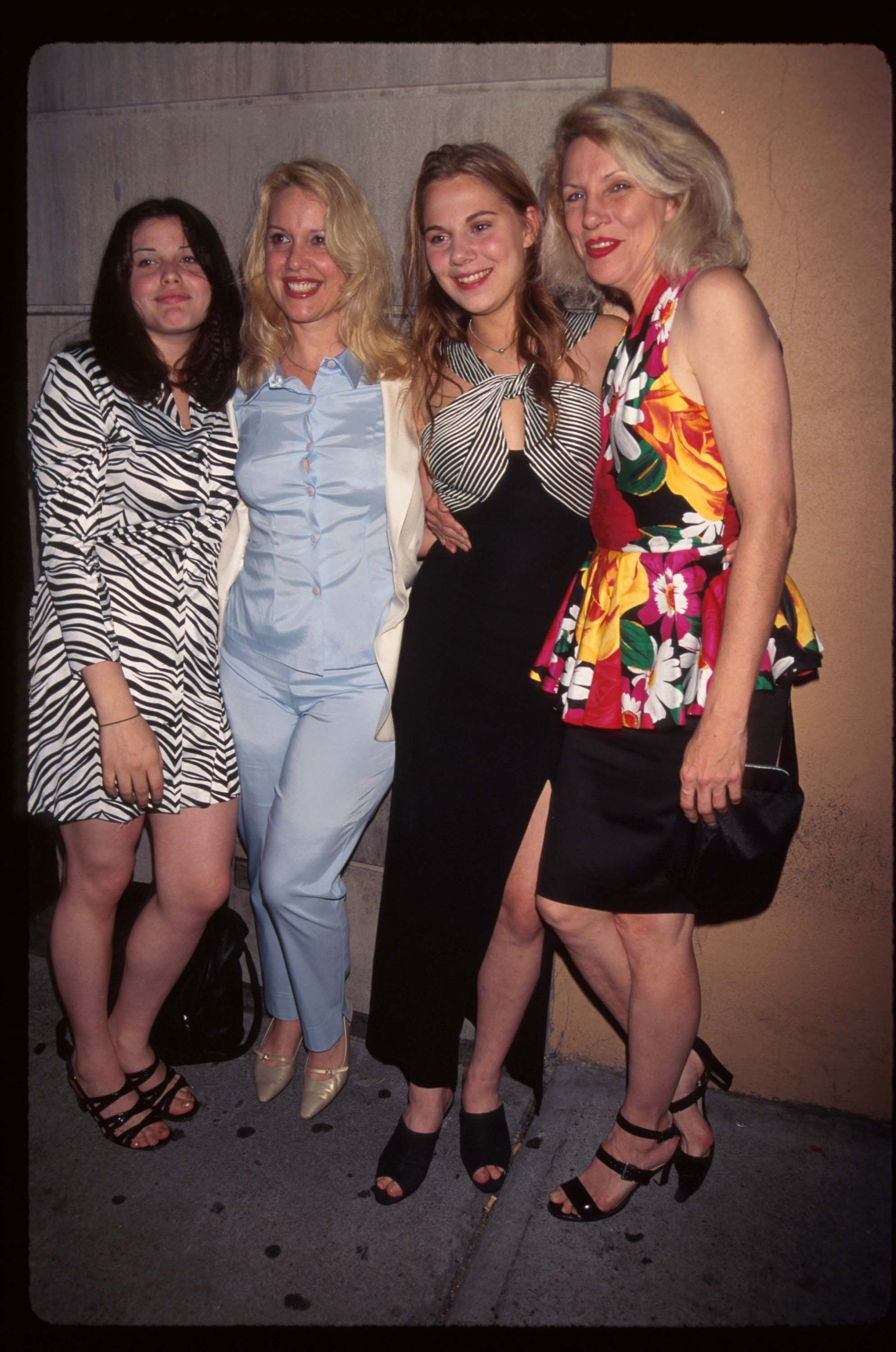 Up-and-coming models Mia Tyler (L) and Stasha Bowie (2nd R) stand with their mothers Cyrinda Foxe (2nd L) and Angie Bowie (R) on July 25, 1996 in New York City. | Source: Getty Images