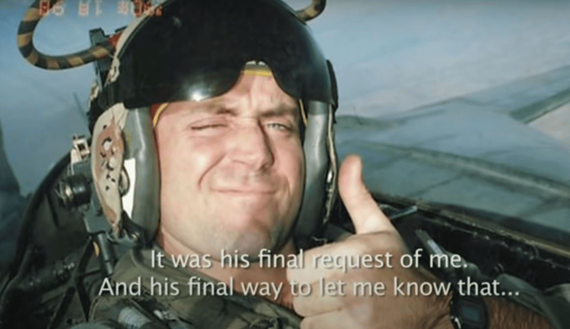 Brian Sweeney posing with a thumbs up while on an aircraft.   Source: YouTube/9/11 Memorial & Museum