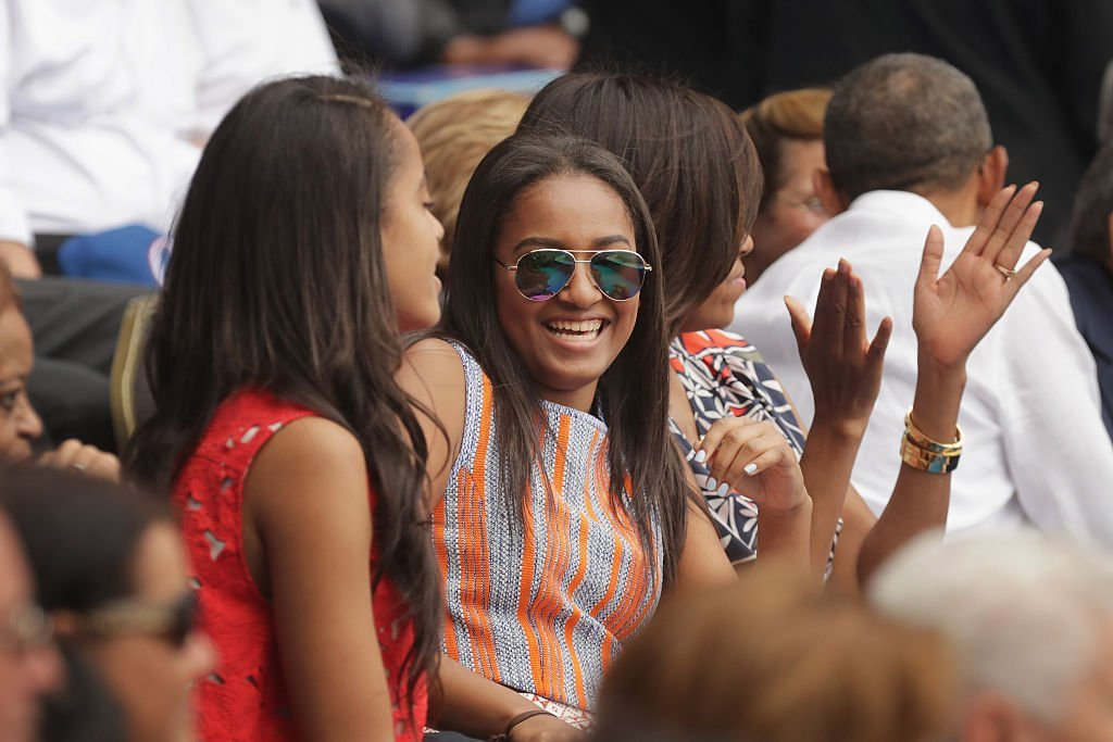 Malia Obama, Sasha Obama, U.S. first lady Michelle Obama and President Barack Obama react to the first run scored during an exhibition game between the Cuban national baseball team and Major League Baseball's Tampa Bay Devil Rays at the Estado Latinoamericano in Havana, Cuba | Photo: Getty Images