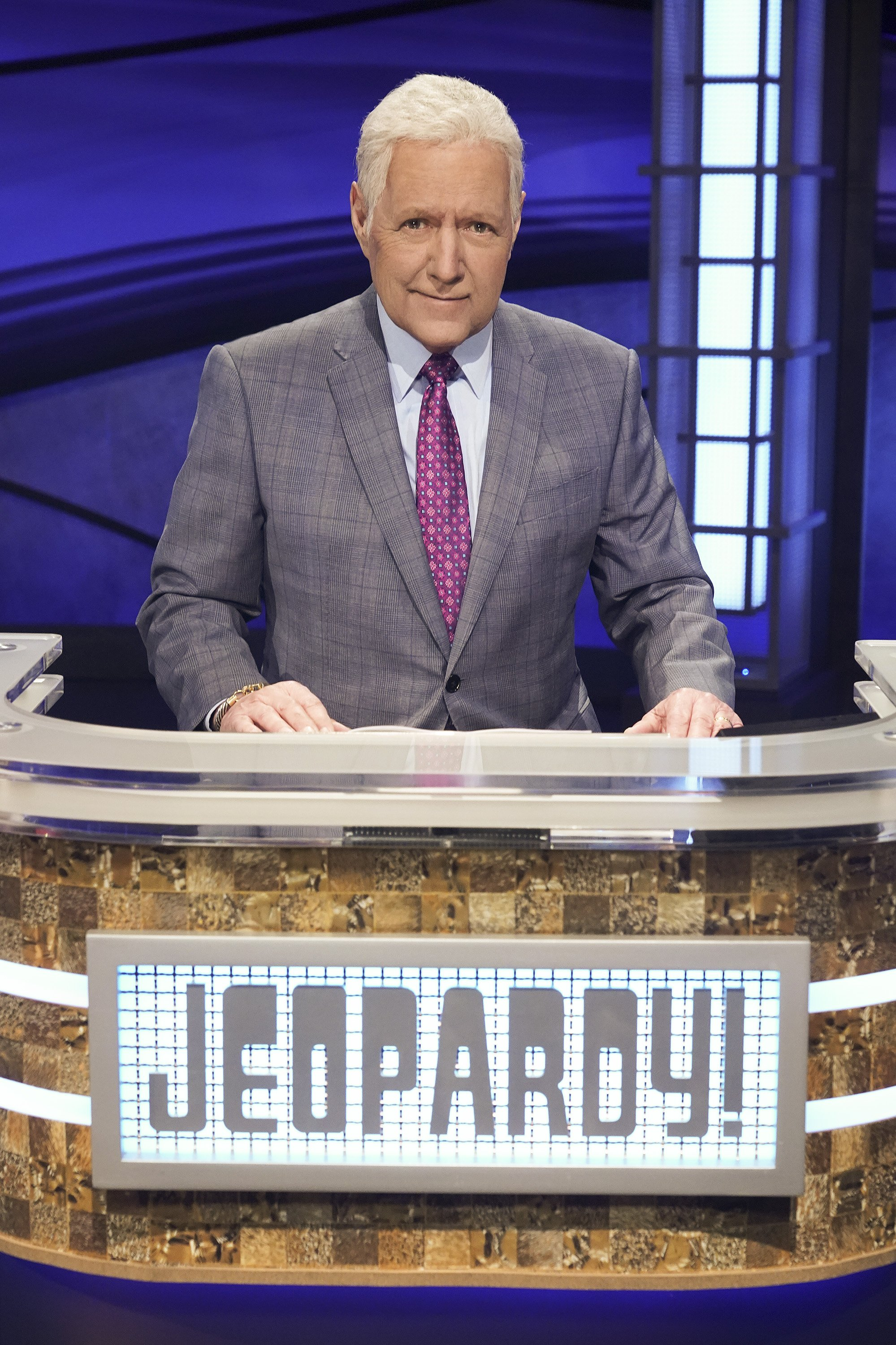 "Alex Trebek pictured behind the ""Jeopardy!"" lectern on an episode of the show. 