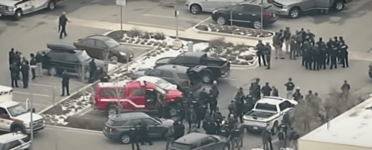 Screenshot of Colorado shooting and cops around the scene.   Source: YouTube/ABC7