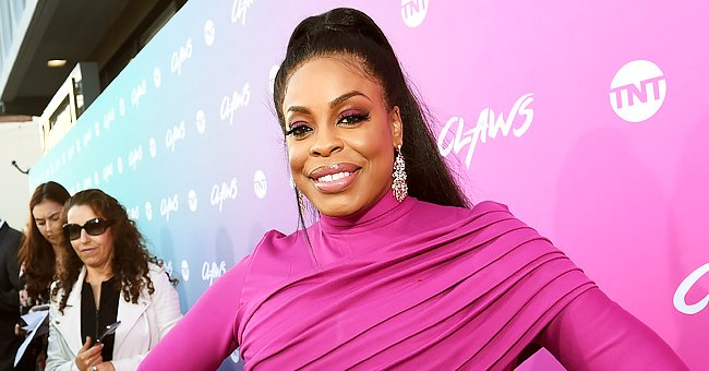 Niecy Nash Displays Her Figure Rocking a Rainbow-Print Crochet Bikini & Matching Skirt (Photos)