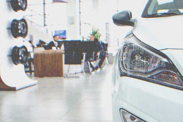 The inside of a car dealership store. | Source: Shutterstock
