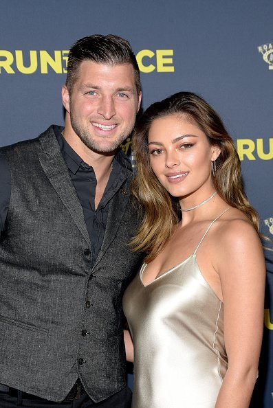 "Tim Tebow and Demi-Leigh Nel-Peters attend the premiere of Roadside Attractions' ""Run The Race"" at the Egyptian Theatre on February 11, 2019 in Hollywood, California 