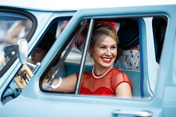 A woman in a vintage car  | Image: Getty Images