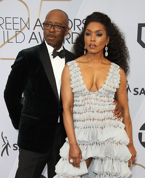 Courtney B. Vance and Angela Bassett attend the 25th Annual Screen Actors Guild Awards at The Shrine Auditorium  | Photo: Getty Images
