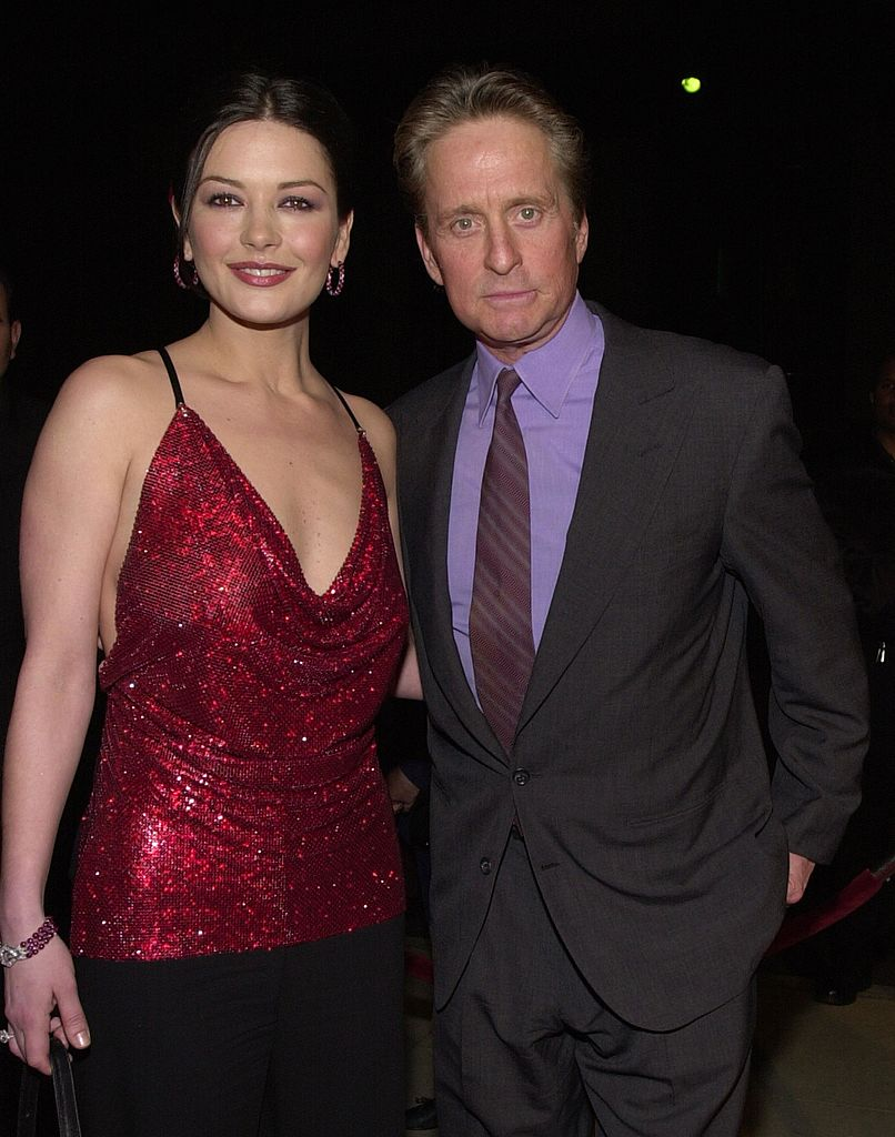 """Catherine Zeta-Jones and her husband Michael Douglas arrive at the premiere of USA Films'' """"Traffic"""" in Beverly Hills, CA 