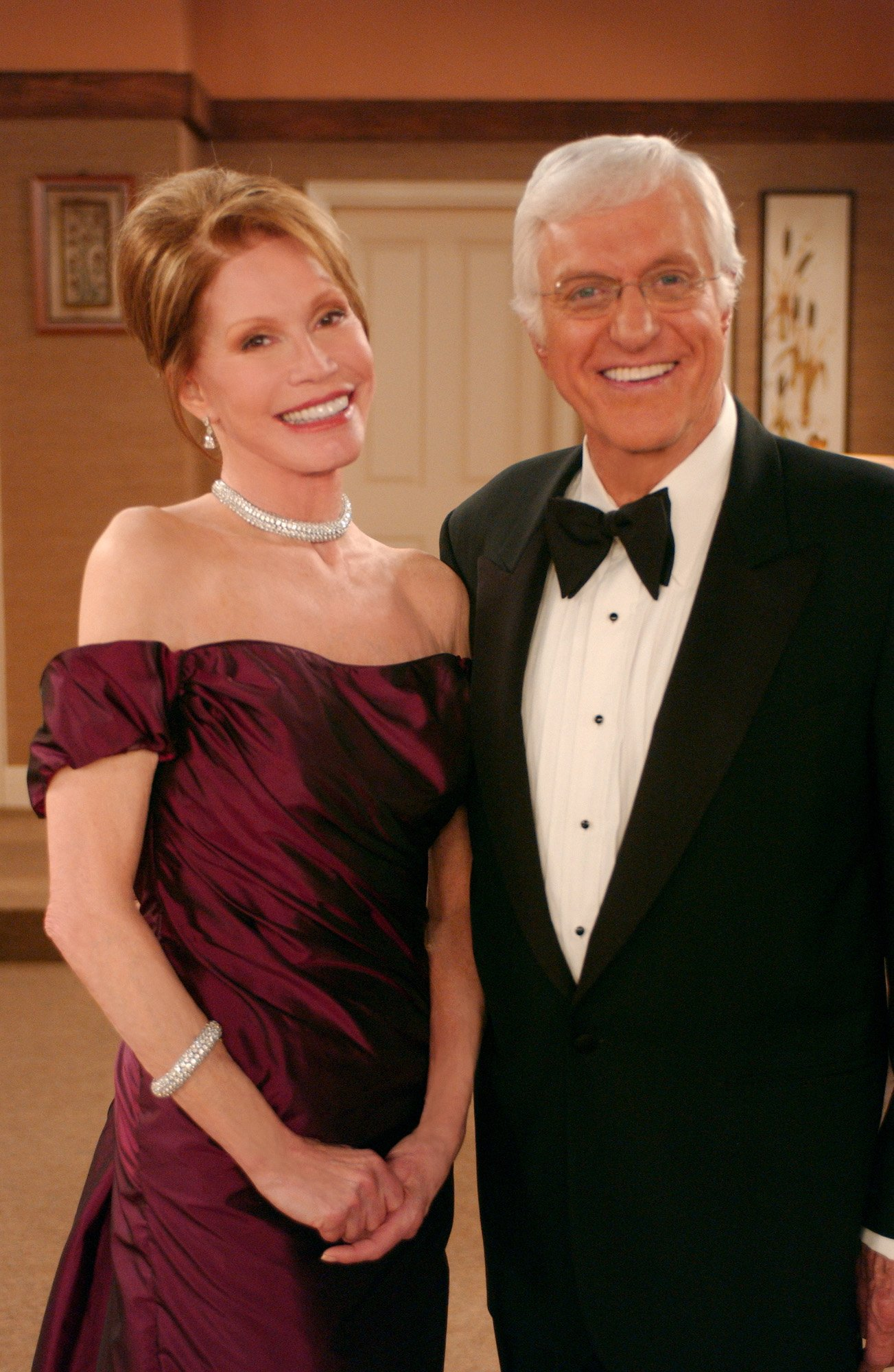 Promotional portrait of American actors Mary Tyler Moore and Dick Van Dyke reprise their roles as Laura and Rob Petrie on 'The Dick Van Dyke Show Revisited,' Los Angeles, California, March 10, 2004. | Source: Getty Images