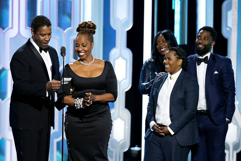Denzel Washington accepting the Cecil B. Demille Award with his family at the 73rd Annual Golden Globe Awards in January 2016. | Photo: Getty Images